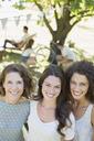 Three women hugging outdoors - CAIF17254