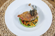 Chicken leg and vegetables on plate - KVF00111