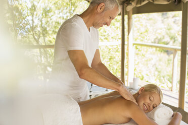 Woman having massage in spa - CAIF17362
