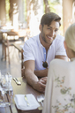 Couple talking in restaurant - CAIF17383