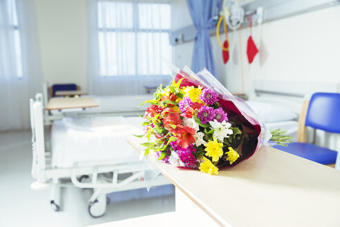 Bouquet of flowers in hospital room - CAIF17424