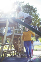 Teacher watching student play on play structure - CAIF17463