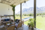 Living room overlooking backyard and landscape - CAIF17544