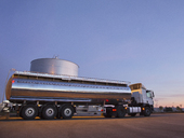 Stainless steel milk tanker next to silage storage tower - CAIF17562