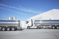 Stainless steel milk tankers parked - CAIF17580