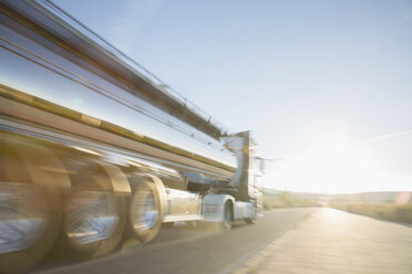 Stainless steel milk tanker on the road - CAIF17592