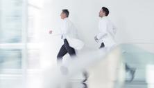Doctors running in hospital corridor - CAIF17616