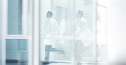 Doctors running in hospital corridor - CAIF17631