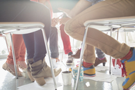 Close up of creative business people meeting in circle of chairs - CAIF17730