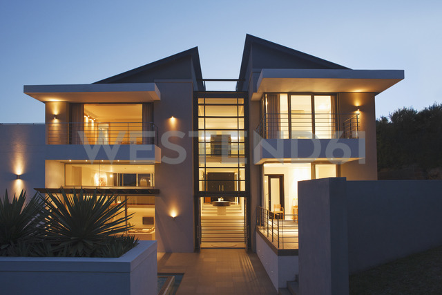 Modern house illuminated at night - CAIF17853