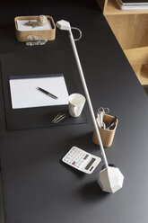 Objects and modern lamp on home office desk - CAIF17886