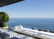 Sofas and infinity pool overlooking ocean - CAIF17943