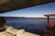 Sofas and infinity pool overlooking ocean - CAIF17946