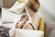 High angle view of mother breast feeding baby girl at home - CAVF09167