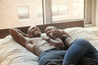 High angle view of couple on bed at home - CAVF09260