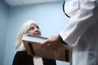 Cropped image of doctor talking with patient in hospital - CAVF09269