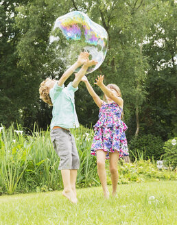 Children playing with bubble outdoors - CAIF18099