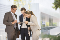 Business people using digital tablet outdoors - CAIF18267
