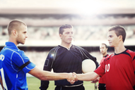 Soccer players shaking hands on field - CAIF18342