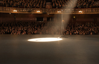Spotlight shining on stage in theater - CAIF18378