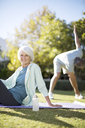 Senior couple exercising in park - CAIF18613