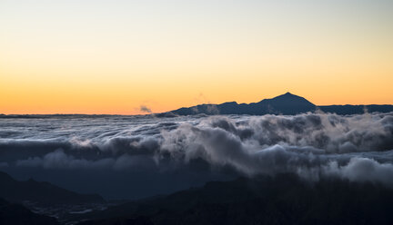 Spain, Canary Islands, Gran Canaria, view from Roque Nublo at sunset with Teide  on Tenerife in background - STCF00429