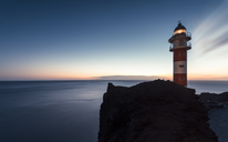 Spain, Canary Islands, Tenerife, Punta de Teno, lighthouse at the coast at dusk - STCF00453