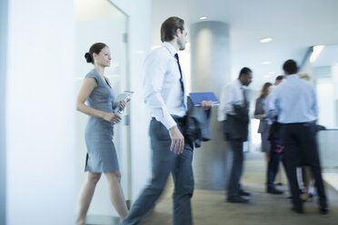 Business people walking in office - CAIF18702