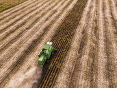 Serbia, Vojvodina, Combine harvester on a wheat, aerial view - NOF00023