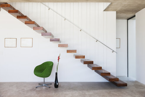 Chair under floating staircase in modern house - CAIF18787