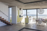Modern kitchen and dining room overlooking ocean - CAIF18796