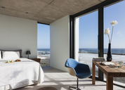 Modern bedroom overlooking ocean - CAIF18808