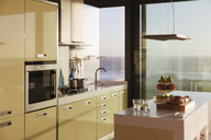 Modern kitchen overlooking ocean - CAIF18817