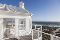 White bedroom overlooking ocean - CAIF18883