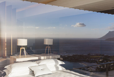 Modern bedroom overlooking ocean - CAIF18958