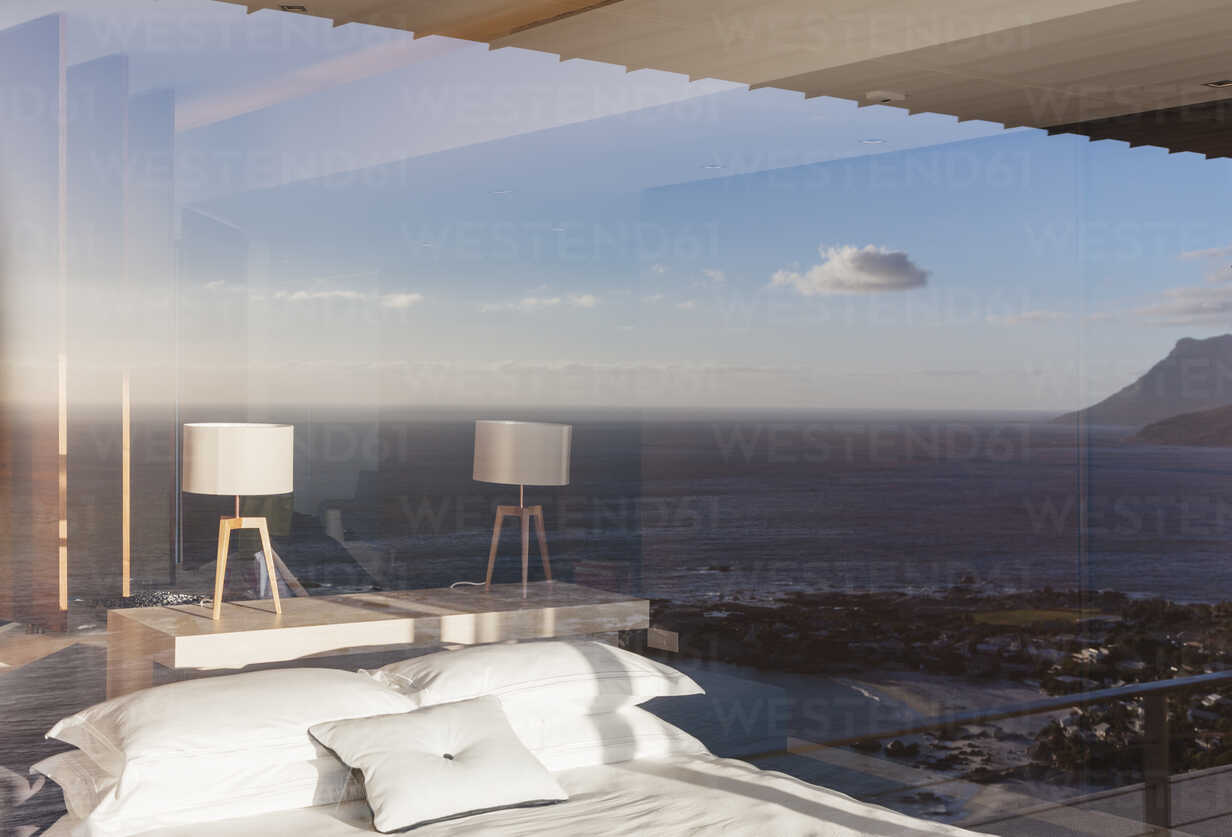 Modern bedroom overlooking ocean - CAIF18958 - Astronaut Images/Westend61
