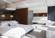 Bedroom and en suite bathroom in modern house - CAIF18967