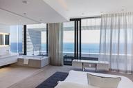 Modern bedroom overlooking ocean - CAIF18976