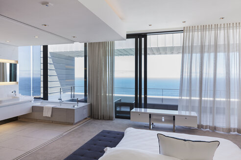 Modern bedroom overlooking ocean - CAIF18976