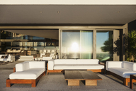 Sofas and table on modern patio - CAIF19030