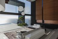 Living room in modern house overlooking ocean - CAIF19039