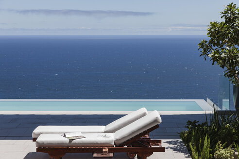 Modern patio and infinity pool overlooking ocean - CAIF19048