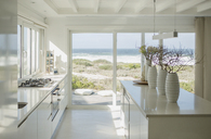 Modern white kitchen with ocean view - CAIF19312