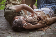 High angle view of sensual couple lying on pier in forest - CAVF09841