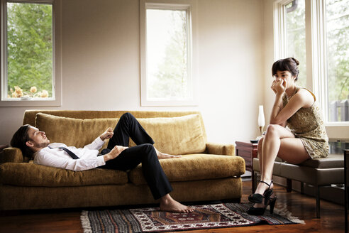 Unhappy couple in living room - CAVF09994