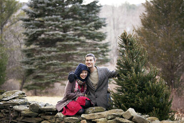 Portrait of happy couple in forest during winter - CAVF10066