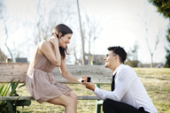 Man proposing to girlfriend at park - CAVF10177