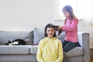 Little girl braiding her sister's hair - LVF06793