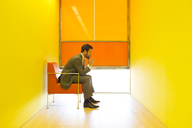 Businessman thinking in bright office - CAIF19681