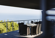 Dining table and chairs on modern balcony - CAIF19816